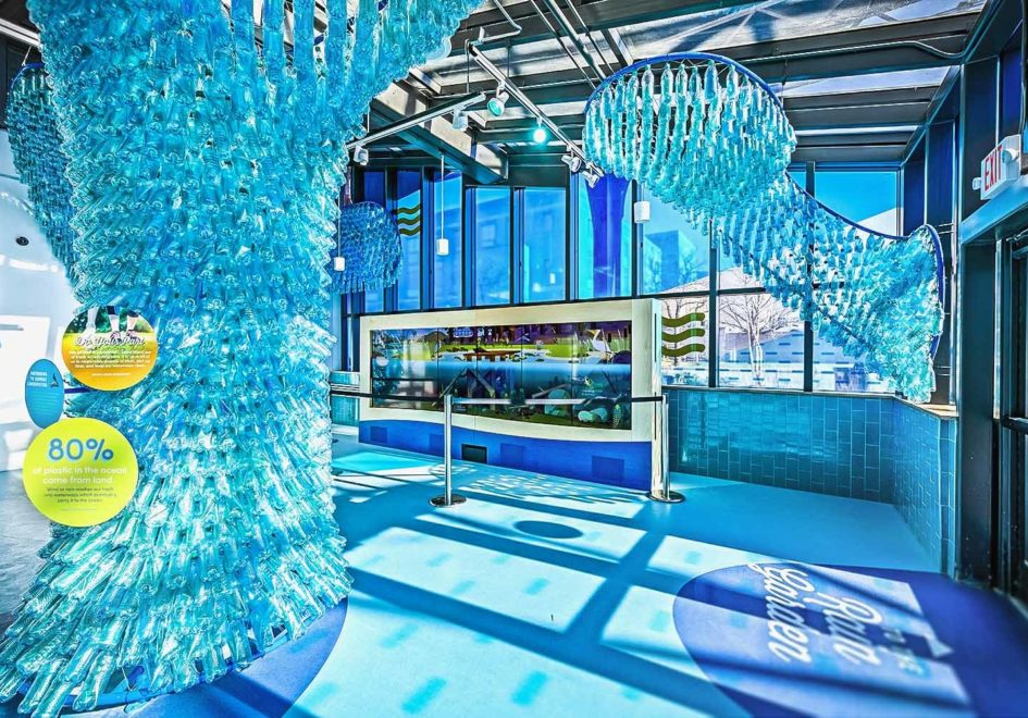 Representing plastic islands floating in the ocean, the bottle sculpture shares information about both water pollution and global solutions.