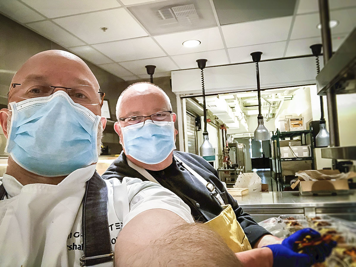 The Brightwater team puts culinary safety first by wearing gloves and masks. They will soon increase to preparing 4,200 meals per week for health care workers.