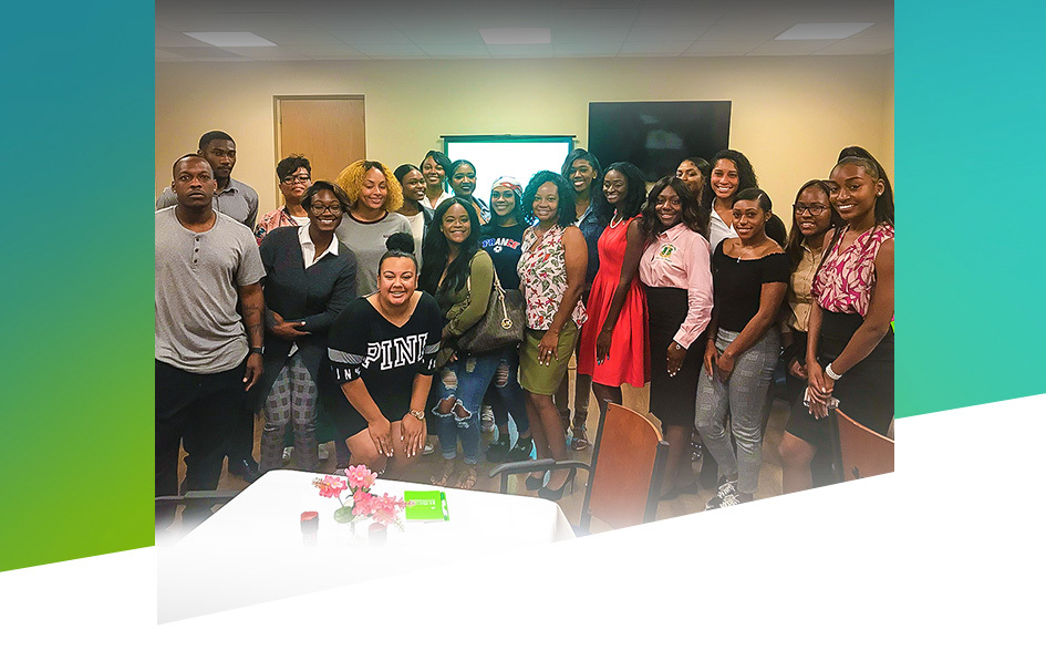 Members of Tennessee State University's Alpha Kappa Alpha sorority smile for the cameras after a Regions financial education seminar in 2018.