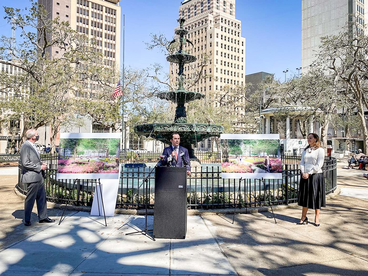 Regions' Mobile Market Executive Christian White, center, speaks during a news conference announcing a $50,000 contribution from Regions Bank. Mobile Mayor Sandy Stimpson, left, and Downtown Parks Conservancy President Kellie Hope, right, look on.