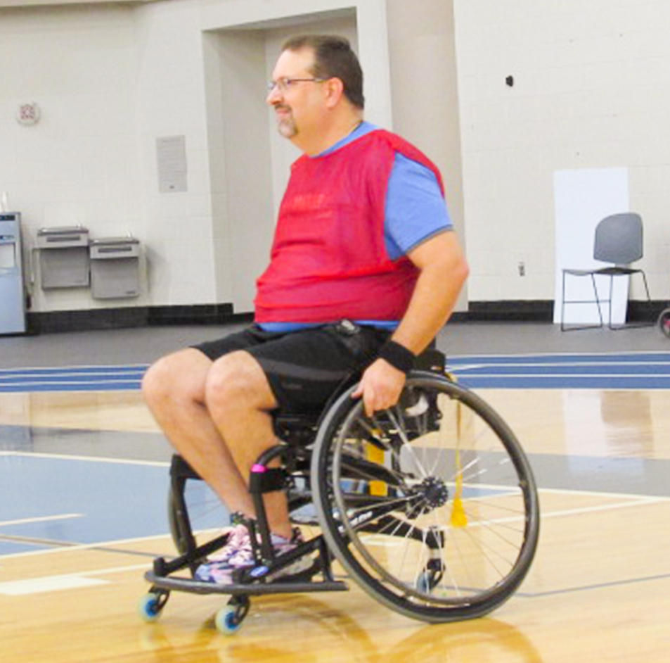 Jacob Couch playing wheelchair basketball
