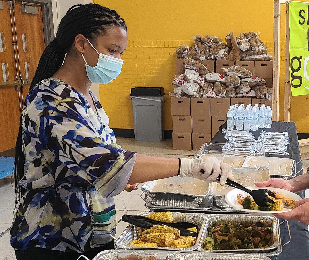 Nicole Woodson serving food